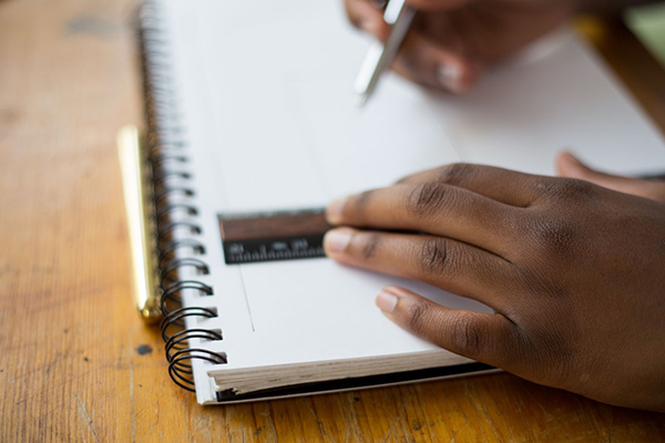 Student Using Notebook